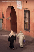 Women walking through Djemma el Fna